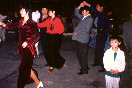 Dancing in a night market
